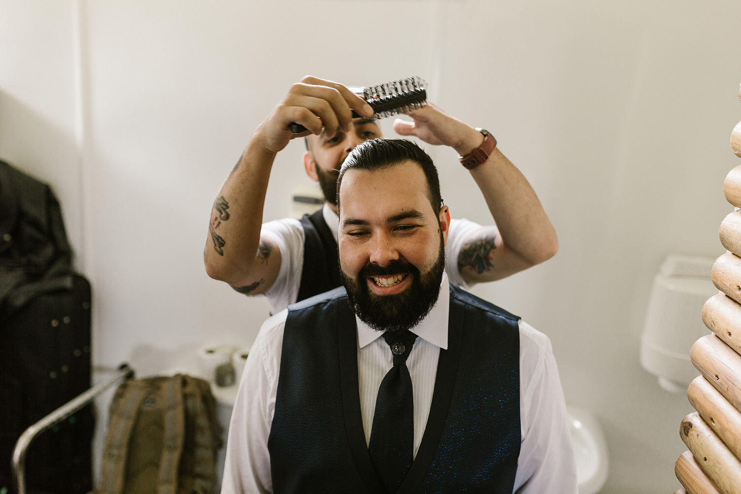 barber getting the groom ready