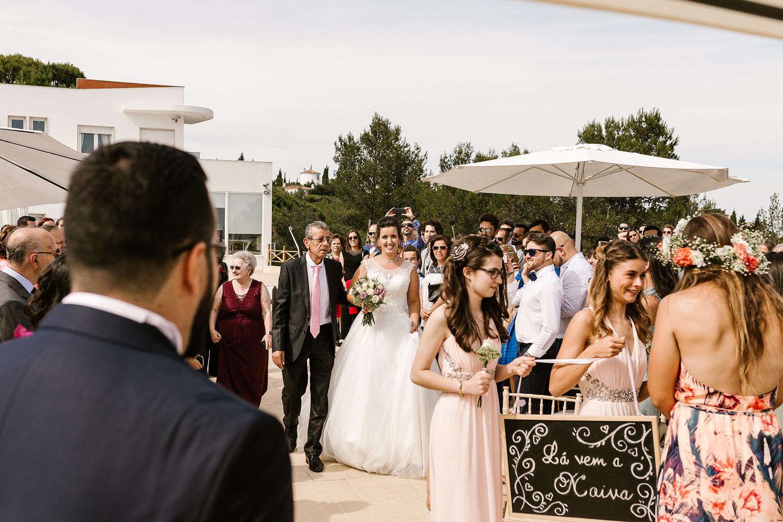 bride walking towards the groom