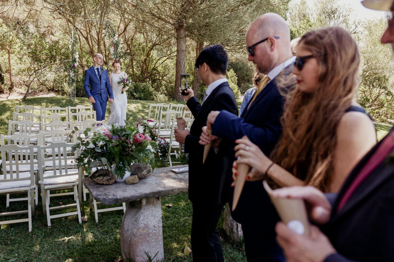 bride and groom walking towards guests