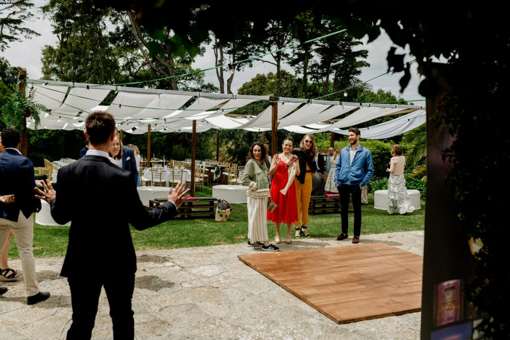 groom greets his friends at the quinta casa portuguesa