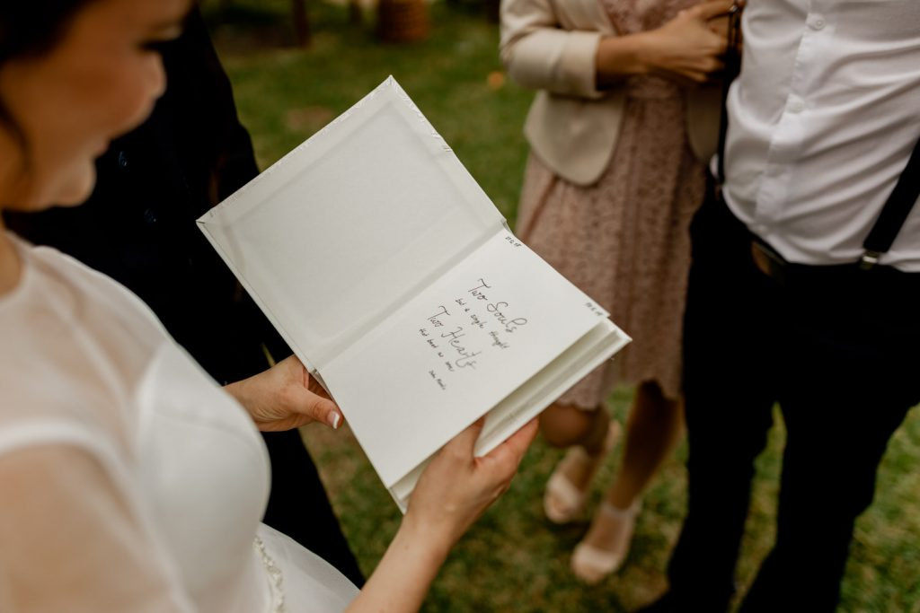 bride reads a note written on a wedding gift
