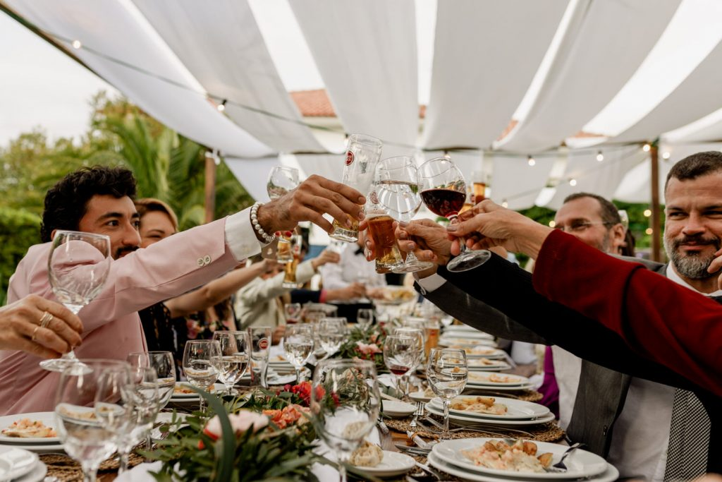 wedding guests make a toast to the bride and groom on their wedding reception