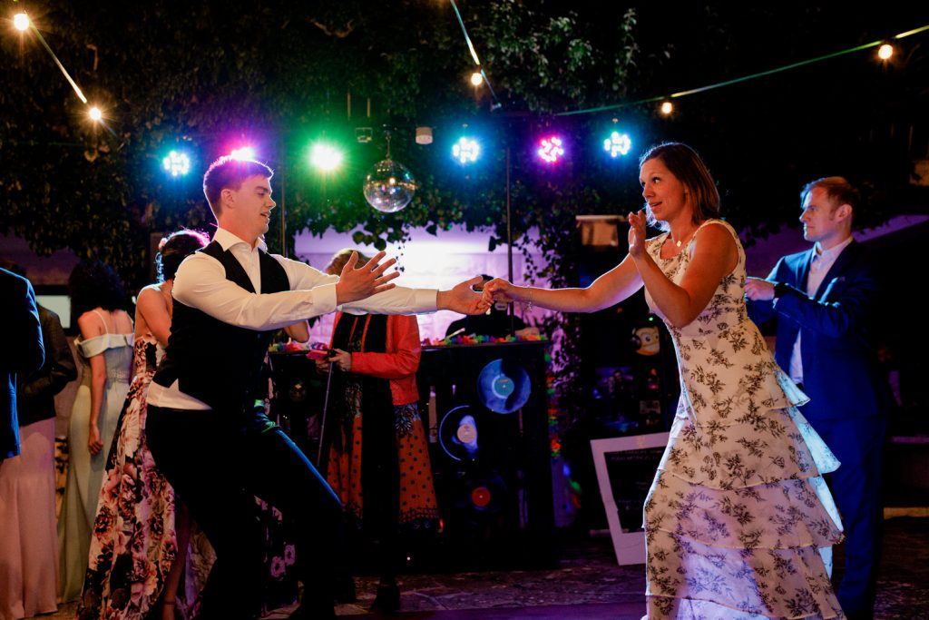 groom dances a tradicional swedish dance in his destination wedding in portugal