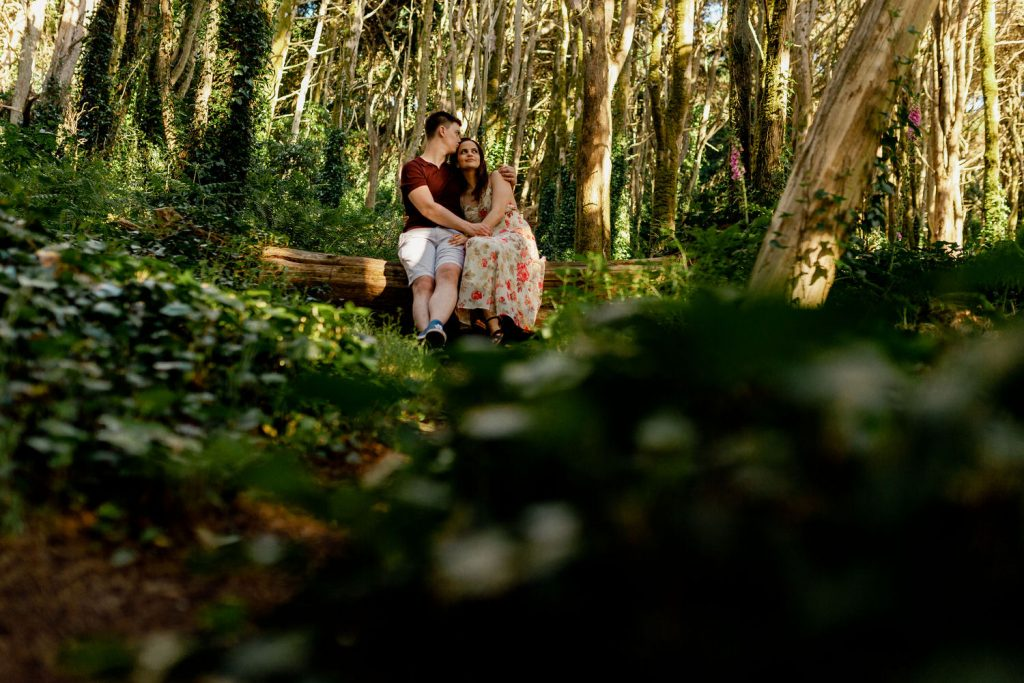 young couple hugging in the woods of Sintra